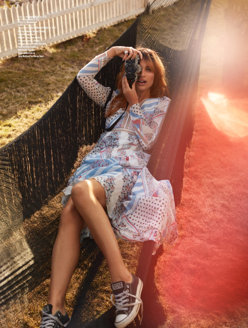 Posing in a hammock, Lise Olsen wears Tommy Hilfiger dress and Converse sneakers