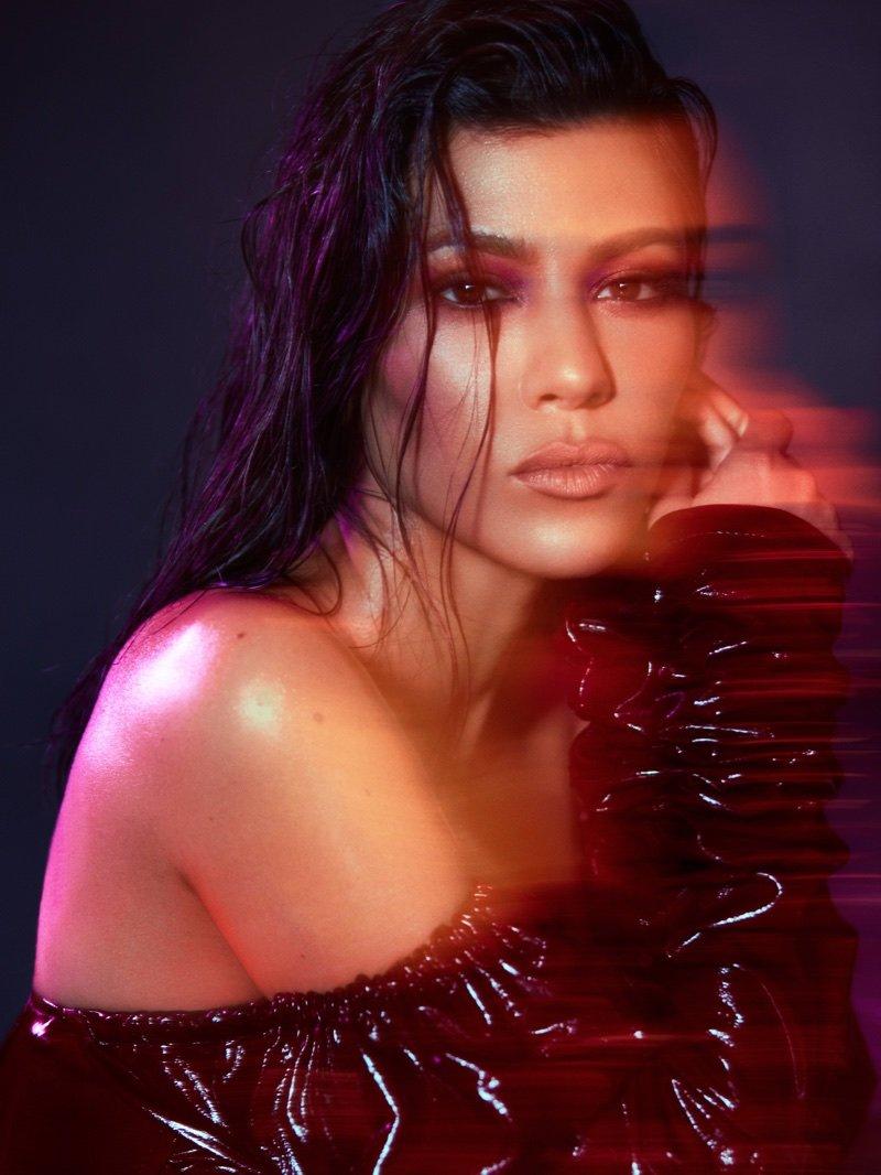 Kourtney Kardashian poses in Zeynep Arcay patent leather dress