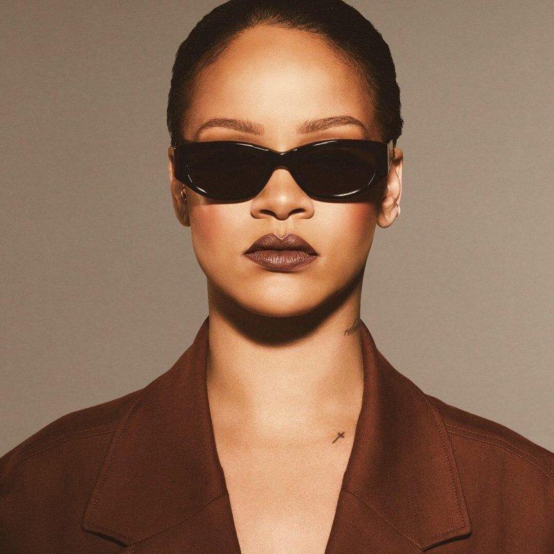 Singer Rihanna wears Fenty Beauty Stunna Lip Paint in Unveil